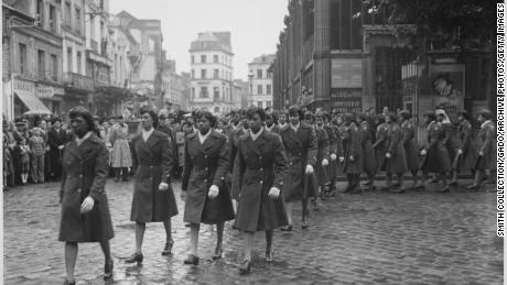 """The battalion on parade in France, 1945. Lena King said she enlisted after a Jewish friend was killed in the Air Force: """"I felt that as an African American, we wanted to show that we were as involved in our country and loved it."""""""