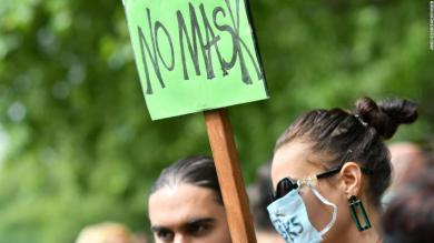 Hundreds of demonstrators, some wearing masks, protest against mask-wearing in London