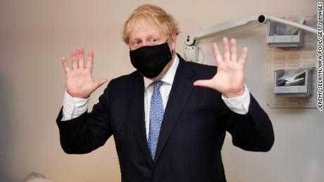 Boris Johnson wears a face mask as he visits Tollgate Medical Centre in Beckton on July 24, 2020 in London.
