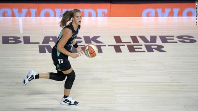 New York Liberty forward Sabrina Ionescu pushes the ball up the court during a WNBA game on Saturday in Florida.