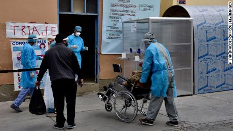 Health workers bring a suspected coronavirus patient to a hospital in La Paz on July 23, 2020.