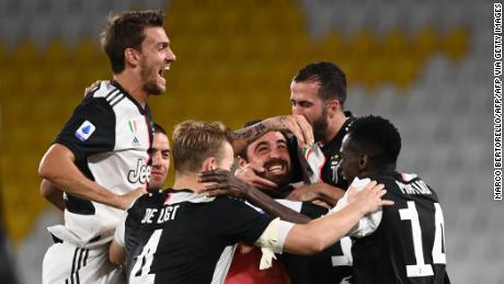 Juventus players celebrate winning the Serie A title.