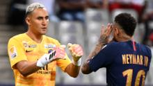 Neymar celebrates with PSG goalkeeper Keylor Navas after scoring his penalty.