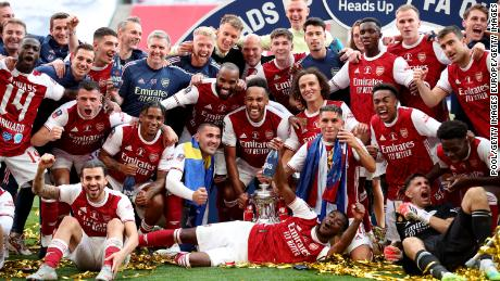 Arsenal players celebrate winning the FA Cup final.