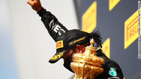 As he has done after previous victories this season, Hamilton raised his fist after collecting the trophy.