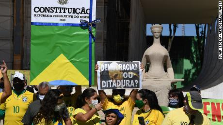 Supporters of Brazilian President Jair Bolsonaro demonstrate to show their support, in Brasilia, on May 31, 2020 during the COVID-19 novel coronavirus pandemic.