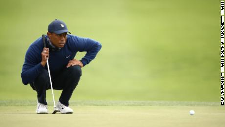 Woods lined a put on the 13th green.