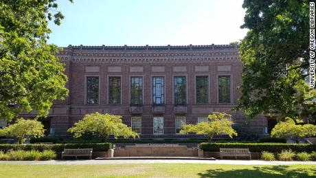 The University of Oregon is covering racist murals in its library, one of which references the need to conserve 'our racial heritage'