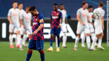 Messi reacts after Bayern Munich scores.
