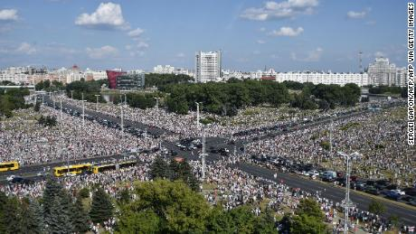 Tens of thousands gather in Minsk to protest, as Lukashenko holds rival demonstration