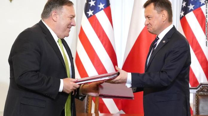 US Secretary of State Mike Pompeo and Polish Minister of Defense Mariusz Blaszczak exchange documents after signing the US-Poland Enhanced Defense Cooperation Agreement in the Presidential Palace in Warsaw, Poland, on August 15, 2020.