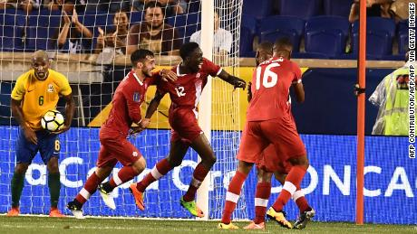 Alphonso Davies celebrates after scoring his first goal for Canada against French Guiana.