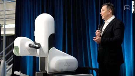 Elon Musk showcases a new working version of the Neuralink brain implant during a livestream on August 28.