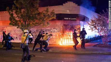 Fires set at Portland police union building as protests continue