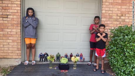"""Kian and his siblings strike """"Wakanda Forever"""" poses during a memorial for Chadwick Boseman."""