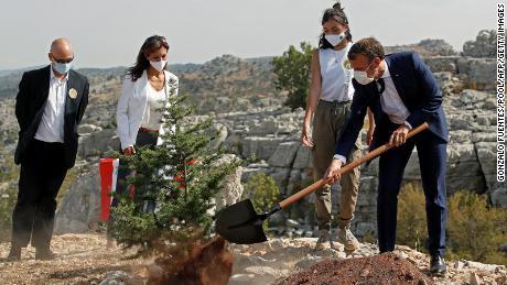 French President Emmanuel Macron plants a cedar tree in Jaj Cedars Reserve Forest, to mark Lebanon's centenary on September 1.