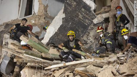 Rescue workers clear rubble from a destroyed building with the aim of finding a potential survivor in the aftermath of the Beirut blast.