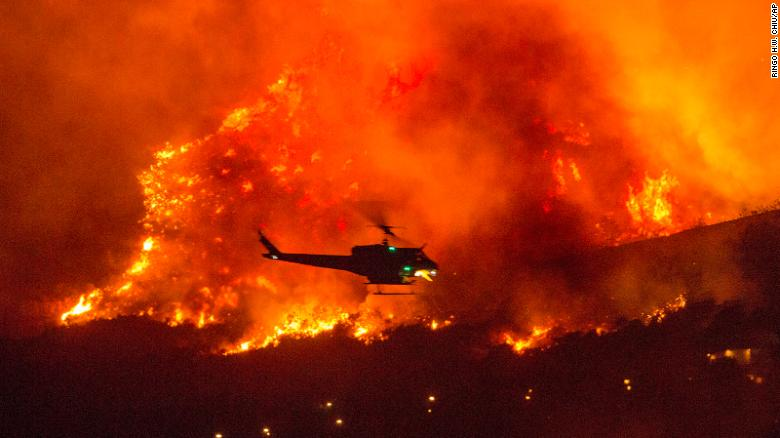 A helicopter prepares to drop water at a wildfire in Yucaipa, California, on September 5.