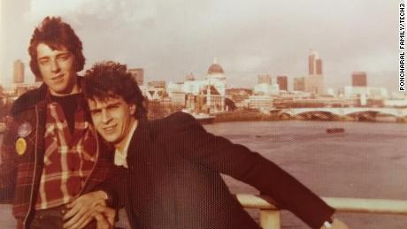 Poncharal and his brother, Olivier, pose for a photo on London's Waterloo Bridge.