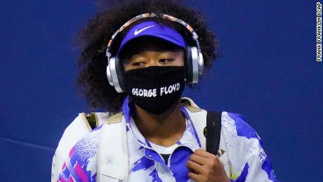 Osaka wears a face mask bearing Floyd's name before her match against Shelby Rogers.