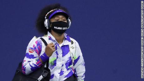 Osaka arrives for her semifinal against Jennifer Brady.