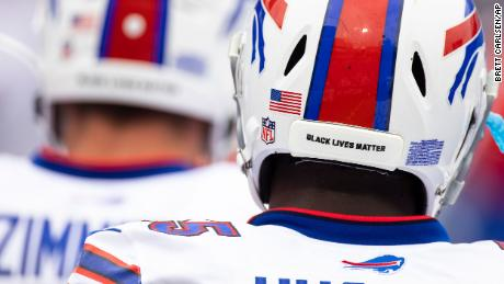 Detail view of a Black Lives Matter sticker on the back of a football helmet worn by Buffalo Bills defensive end Jerry Hughes before the Bills' game against the New York Jets on Sunday, September 13