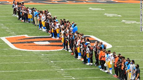 The Cincinnati Bengals and the Los Angeles Chargers stand in unity during the National Anthem at Paul Brown Stadium in Cincinnati, Ohio, on Sunday, September 13.