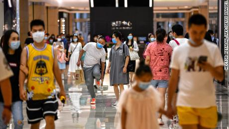 China's economy shrugs off global slump as shoppers join the recovery