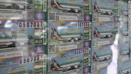 View of lottery tickets depicting the luxurious presidential plane in Mexico City, on March 10, 2020.