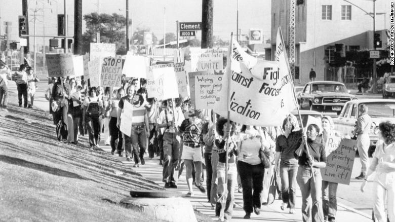 "Demonstrators march outside at the Los Angeles County USC Medical Center in 1974 at a protest organized by ""The Committee to Stop Forced Sterilization."""