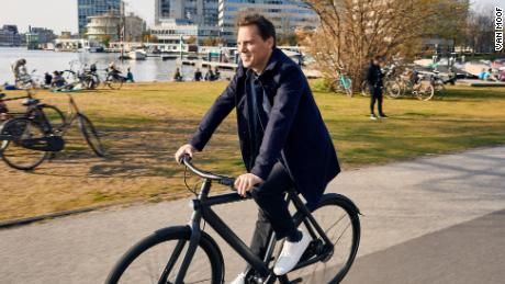 Van Moof CEO Taco Carlier rides one of his company's electric bikes.