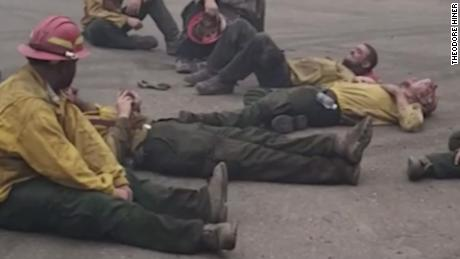 Firefighters sing together after a 14-hour shift battling wildfires in Oregon