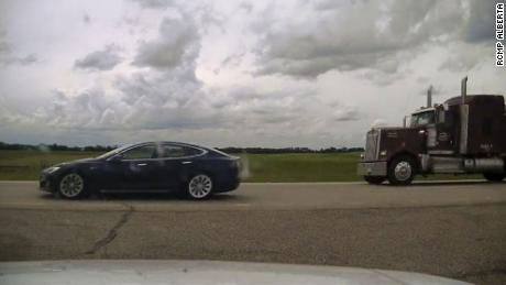Canadian police have charged a 20-year-old man with dangerous driving after he was found apparently asleep at the wheel of a Tesla.