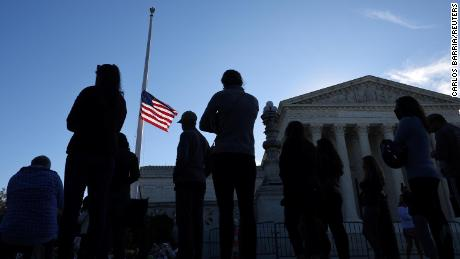 As the nation mourns an icon, Democrats and Republicans fight over Supreme Court vacancy