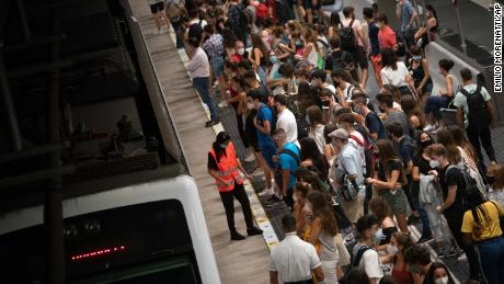 Students wait for a train to university, during rush hour in Barcelona, Spain, on Thursday.