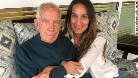 Victoria Cerrone had to wait six months to visit her father, Vittorio Cerrone, inside a memory care facility. This photo captures the lasting memory.