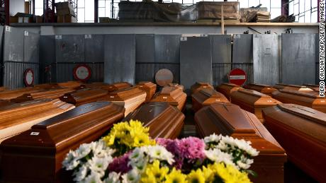 A general view shows some of the 35 coffins of the deceased stored in a warehouse in Ponte San Pietro, near Bergamo, Lombardy, on March 26, 2020, before being taken to another region for cremation during the country's lockdown.