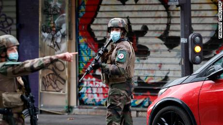 Soldiers patrol Paris after the knife attack.