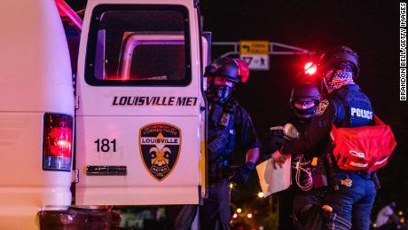 Police officers put a protester in the back of a van on Saturday in Louisville.