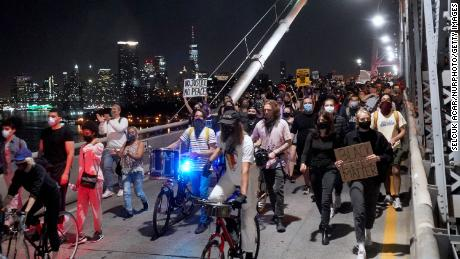 Black Lives Matter protesters from different races marched from the Barclays Center to the Brooklyn Bridge on Saturday night.