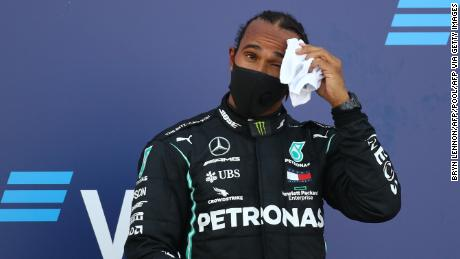 Hamilton reacts on the podium after finishing third in the Russian GP.