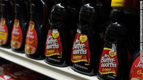 Mrs. Butterworths products seen displayed on supermarket shelves.