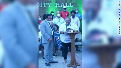 Betty Lewis, wife of the late Julian Lewis, speaks at a candlelight vigil in his honor held in downtown Sylvania, Georgia on August 14, 2020.