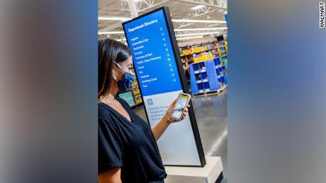 Walmart's new sign mimics the airport.