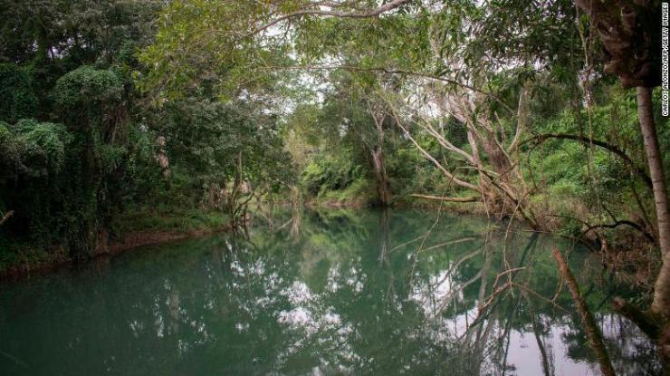 A view of the Mopan River in Melchor de Mencos, Guatemala, part of the Maya Biosphere Reserve.