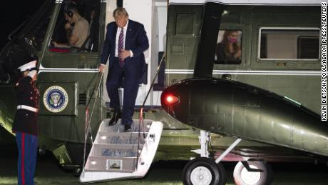 President Donald Trump walks off Marine One as Hope Hicks is seen through the window as he returns to the White House following a trip to the west coast, on September 14, 2020 in Washington, DC. Photo by Kevin Dietsch/Pool/ABACAPRESS.COM