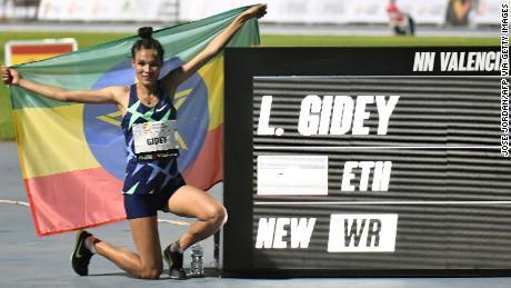 Ethiopia's Letesenbet Gidey celebrates after breaking the 5,000m world record.