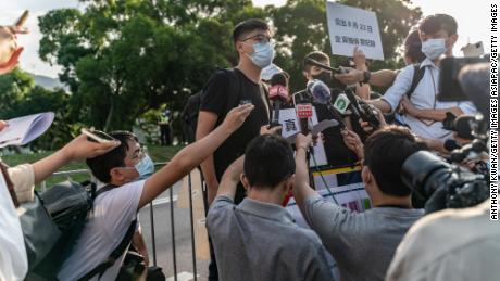 Pro-democracy activist Joshua Wong speaks to members of media outside the Government Flying Service on October 8, 2020.