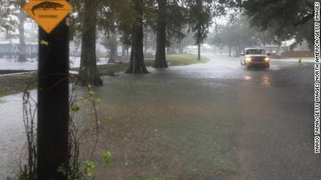 A truck drives through standing water Friday in Lake Arthur, Louisiana.