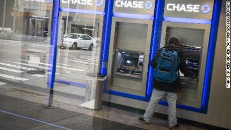 Banks make billions on overdraft fees. Biden could end this